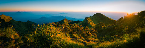 Panoramic view of sunrise. Panoramic view of Mt. Merbabu and surrounding mountains during sunrise near Yogya in central Java province in Indonesia. In this Royalty Free Stock Image