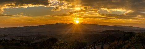 Panoramic view at the sunset above the Tuscany countryside from Volterra in Italy royalty free stock photography