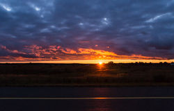 Panoramic view of the sunset among the blue clouds the sun is falling behind Royalty Free Stock Images