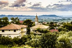 Interior panoramic view of zakynthos with church. Panoramic view of a sunset on the island of zakynthos with old bell tower of an orthodox church and in the Stock Photos