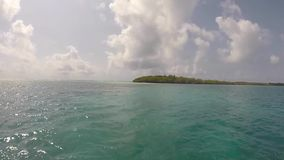 Panoramic view of the sunset on the Lake Maracaibo, VenezuelaTropical islands in Morrocoy National Park with cloudy blue sky. Front view from the boat of the stock video