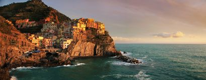 Panoramic view at sunset of Manarola. View at sunset of Manarola in National Park of Cinque Terre, Ligury, Italy Stock Images