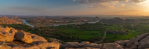 Panoramic view at sunset from the monkey temple hill over hampi india. Karnakata royalty free stock photos