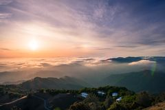 Panoramic view of a sunset over a sea of clouds covering south San Francisco bay area; beautiful rolling hills in the foreground;. View from Mt Hamilton, San stock image