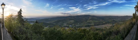 Panoramic view with sunset from town Radda in Chianti to beautiful Tuscany. In Italy royalty free stock photography