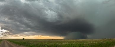 Panoramic view of supercell thunderstorm over the high plains in Oklahoma with a dramatic green sky. Panorama of a HP High Precipitation supercell with a stock photo