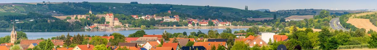 Huge panorama of the sweet lake with the surrounding villages stock images