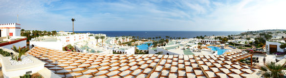 Panoramic view on swimming pool and beach at luxury hotel Royalty Free Stock Photos