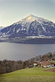 Panoramic view of Swiss mountain near the Thun lake in winter Royalty Free Stock Images