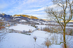 Panoramic view of swiss mountains landscape on a sunny winter da Royalty Free Stock Photos