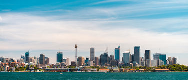 Panoramic view at Sydney city urban skyline. From Western Plains with blue sky and clouds on a bright day Stock Image