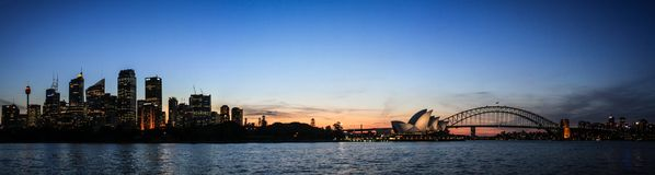 Panoramic view of Sydney at dusk from Mrs Macquarie`Chair, Sydney, New South Wales, Australia. Sydney, capital of New South Wales and one of Australia`s largest royalty free stock photography