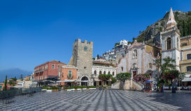 Panoramic view of Taormina main square with Mount Etna Volcano on background - Taormina, Sicily, Italy. Panoramic view of Taormina main square Piazza IX Aprile stock photos