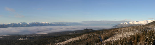 Panoramic view of The Tatra Mountains early in the morning. Royalty Free Stock Images