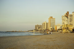 Panoramic view of Tel-Aviv beach on a morning with tourists behi Royalty Free Stock Images