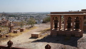 Panoramic view of temple ruins and Jodhpur cityscape in background. stock video
