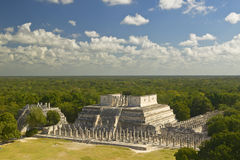 A panoramic view of the Temple of the Warriors out of jungle at Chichen-Itza. A Mayan ruin, in the Yucatan Peninsula, Mexico Royalty Free Stock Photo
