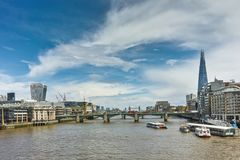 Panoramic view of Thames river and City of London, Great Britain. LONDON, ENGLAND - JUNE 15, 2016: Panoramic view of Thames river and City of London, Great royalty free stock image