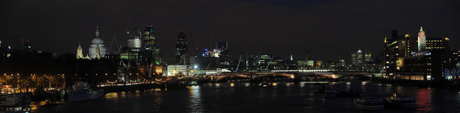Panoramic view of the Thames skyline at night. From St Paul's Cathedral, the City, Monument and Blackfriars Bridge, to Canary Wharf and the South Bank Stock Photography