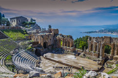 Panoramic view of the theater of taormina and mediterranean back. Close-up of ancient greek theater of taormina italian coast and mediterranean sea sicily Royalty Free Stock Photography