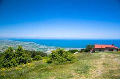 Panoramic view of Thermaikos Gulf of Aegean sea and Khalkidiki or Halkidiki peninsula seen from Olympus mountains near building of. Tavern cafe in Greece royalty free stock images
