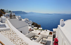 Panoramic view of Thira Town - Santorini Island, Cyclades in Greece. Panoramic view of Thira Town. Famous white buildings in Santorini Island, Cyclades in Greece Royalty Free Stock Image