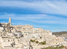 Panoramic view of tipical stones and church of Matera under blue sky Stock Photo