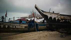 Panoramic view to Accra beach with the fishermans boat, Ghana stock image