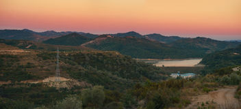 Panoramic view to Albanian countryside nature. A small lake surrounded by hills and forests in the countryside between Tirana and Durres in Albania. Captured Stock Photo
