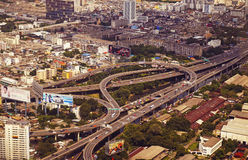 Panoramic view to the Bangkok and the traffic multilevel crossin Royalty Free Stock Images