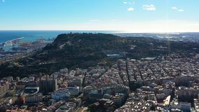 Panoramic view to Barcelona. Montjuic hill and harbour. Video footage. Panoramic view to Barcelona. Montjuic hill and harbour. Drone Video footage stock video