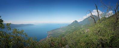 Panoramic view to garda lake and gargnano village, italy Royalty Free Stock Photography