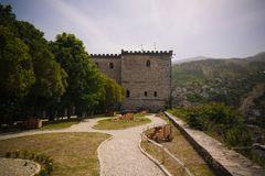 Panoramic view to Gjirokastra castle with the wall, Gjirokaster, Albania. Panoramic view to Gjirokastra castle with the wall and Clock, Gjirokaster, Albania stock photos