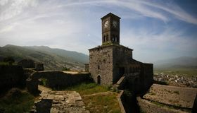 Panoramic view to Gjirokastra castle with the wall, tower and Clock, Gjirokaster, Albania. Panoramic view to Gjirokastra castle with the wall, tower and Clock in stock photography
