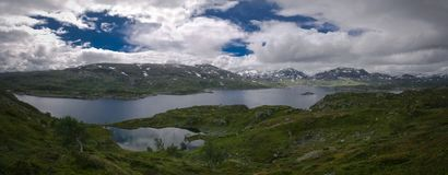 Panoramic view to Hardangervidda plateau and Kjelavatn lake in Norway. Panoramic view to Hardangervidda plateau and Kjelavatn lake, Norway Royalty Free Stock Images