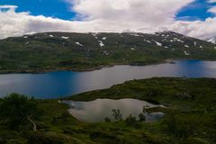Panoramic view to Hardangervidda plateau and Kjelavatn lake in Norway. Panoramic view to Hardangervidda plateau and Kjelavatn lake, Norway Stock Image
