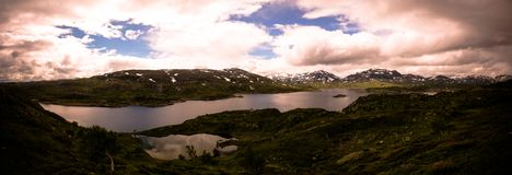 Panoramic view to Hardangervidda plateau and Kjelavatn lake in Norway. Panoramic view to Hardangervidda plateau and Kjelavatn lake, Norway Stock Photo