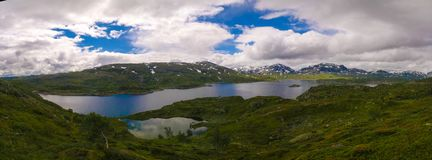 Panoramic view to Hardangervidda plateau and Kjelavatn lake in Norway. Panoramic view to Hardangervidda plateau and Kjelavatn lake, Norway Royalty Free Stock Photos