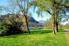 Panoramic view to lake Como lakefront recreation zone in an autumn sunny day. Royalty Free Stock Photography