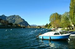 Panoramic view to lake Como, seagulls and motorboat in a spring sunny day. Stock Photo