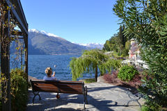 Panoramic view to lake Como in spring with a lady  Royalty Free Stock Photography