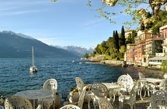 Panoramic view to lake Como from Varenna catering space at lakefront. Royalty Free Stock Photo