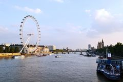 Panoramic View to London Eye, Thames river and City of London at sunny sunset. royalty free stock photo
