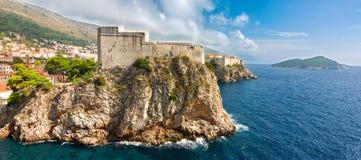 Lovrijenac fortress in Dubrovnik. Panoramic view to Lovrijenac fortress and Dubrovnik old town. Copy space in sky Stock Photography