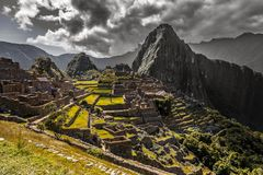 Panoramic view to old Inca ruins and Wayna Picchu with grey clou. Ds in the background, Machu Picchu archaeological site, Urubamba provnce, Peru stock images