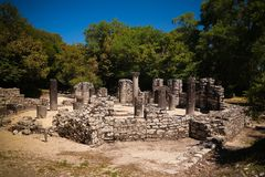 Panoramic view to Remains of the baptistery ruins of ancient town of Butrint , Sarande, Albania royalty free stock photos
