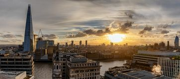Panoramic view to the skyline of London during sunset. Along the Thames with various tourist attractions royalty free stock images