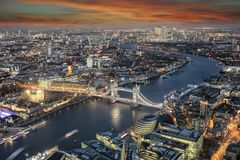 Panoramic view to the skyline of London during sunset time. Panoramic view to the skyline of London: from the Tower Bridge along the Thames river to Canary Wharf royalty free stock image