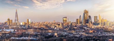 Panoramic view to the skyline of London, UK, during a golden sunrise. From the City to the Tower Bridge royalty free stock photo