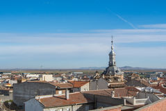 A panoramic view to spanish town Consuegra. Castilla-La Mancha and a church over the orange tile roofs on sunny day Royalty Free Stock Photos